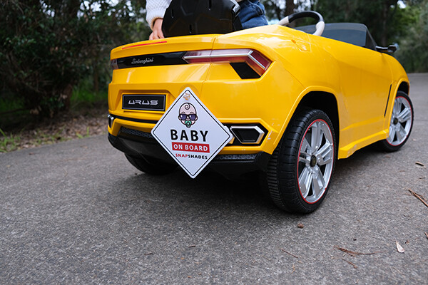 Snap Shades Baby on Board sign on Urus